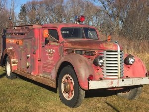 Photo of the first fire truck ever purchased in the RM of Piney.